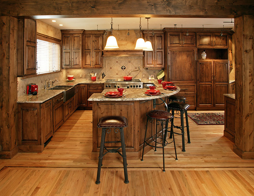 These dark wood cabinets truly enhance the rustic feel of this well thought out kitchen.